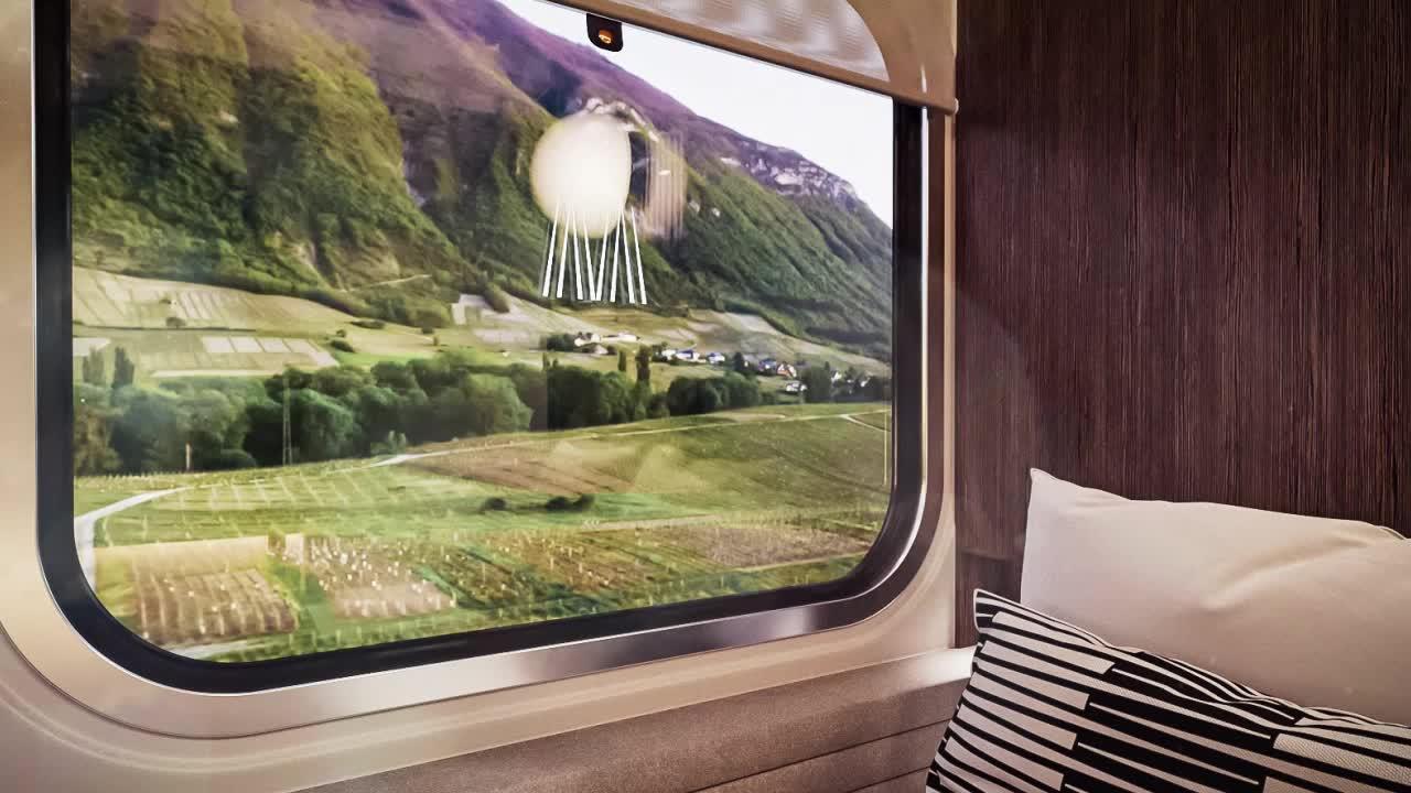 View of a verdant landscape through a train window