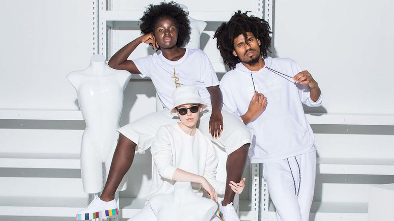 Three models pose in Phluid's clothing