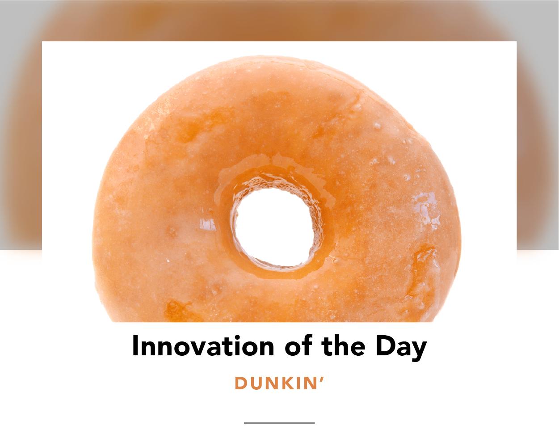 A glossy, original glazed vegan Dunkin' donut
