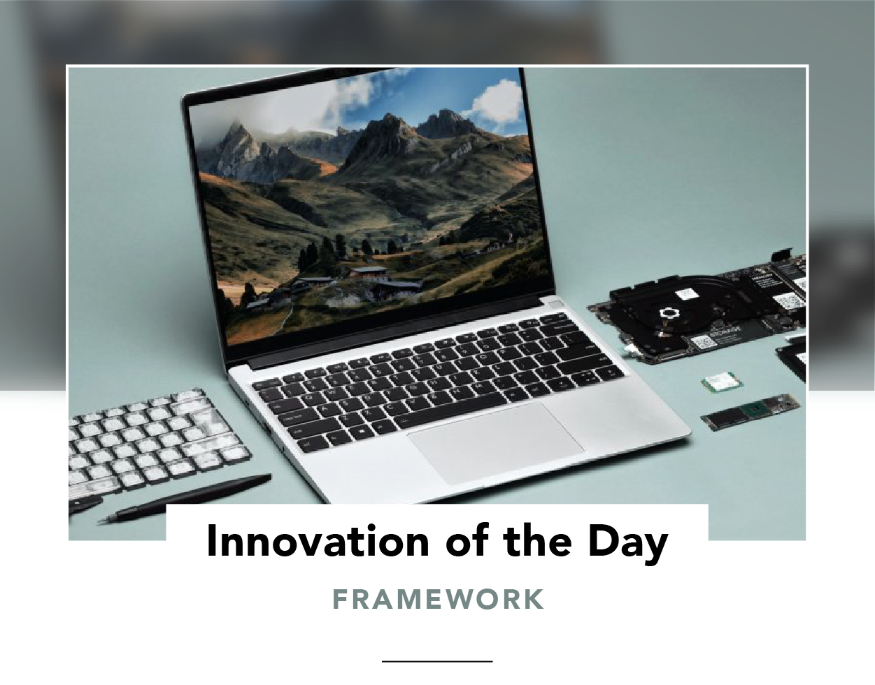 Framework laptop surrounded by a screwdriver and replaceable parts