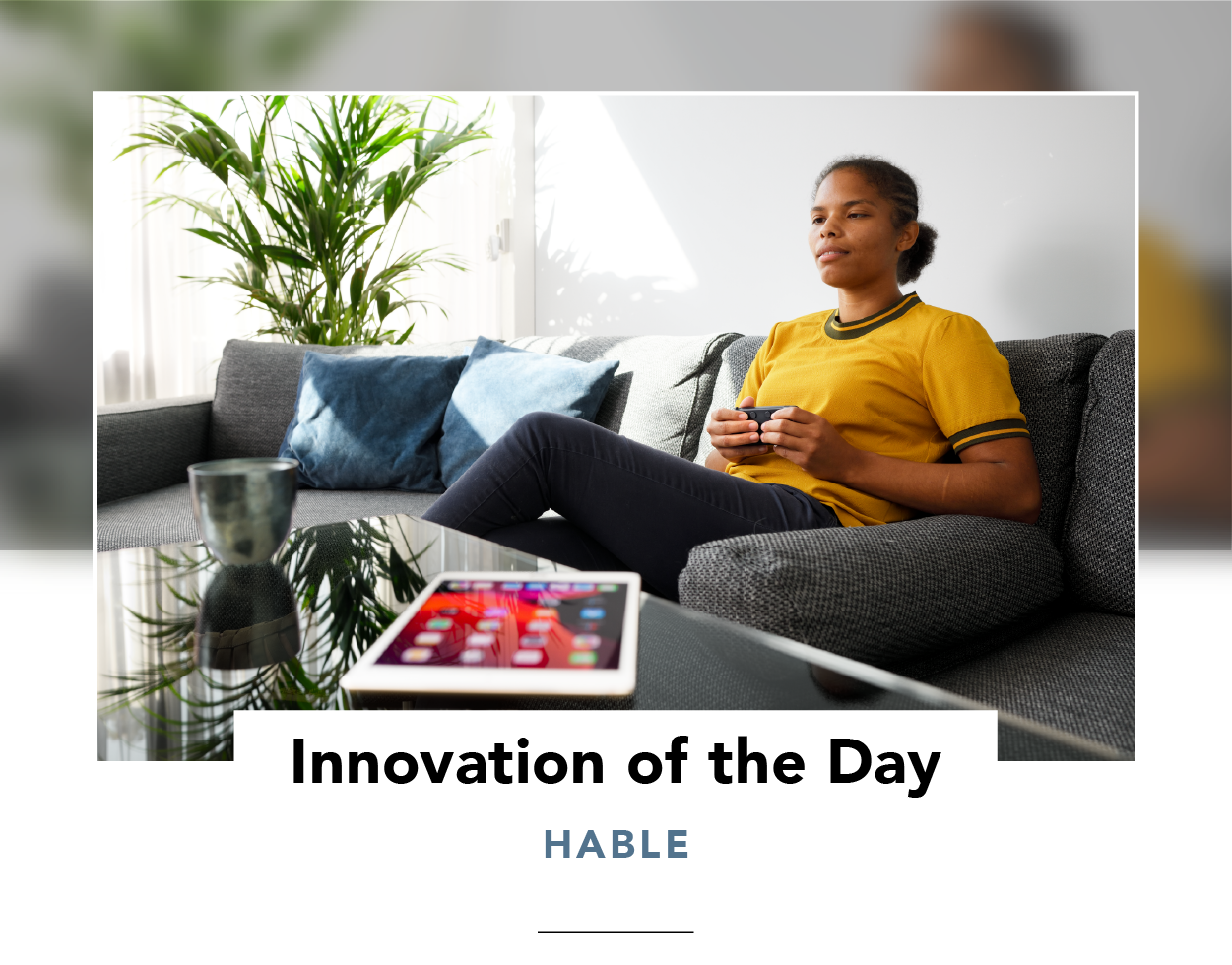 Woman on a couch, using a Hable One wireless keyboard with an iPad