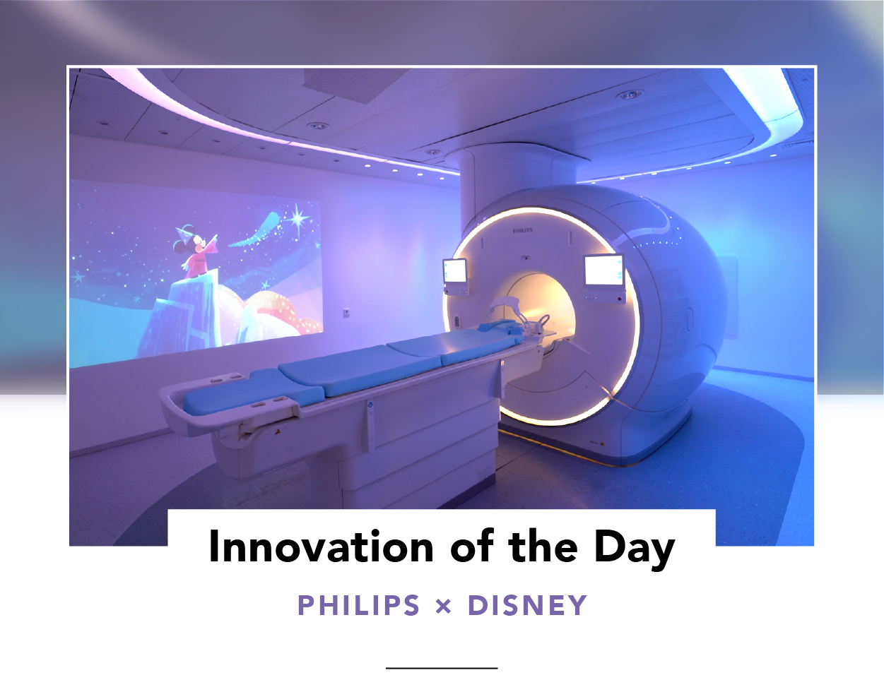 Exterior view of an MRI scanner with soft, ambient lighting and Mickey Mouse projected on a wall