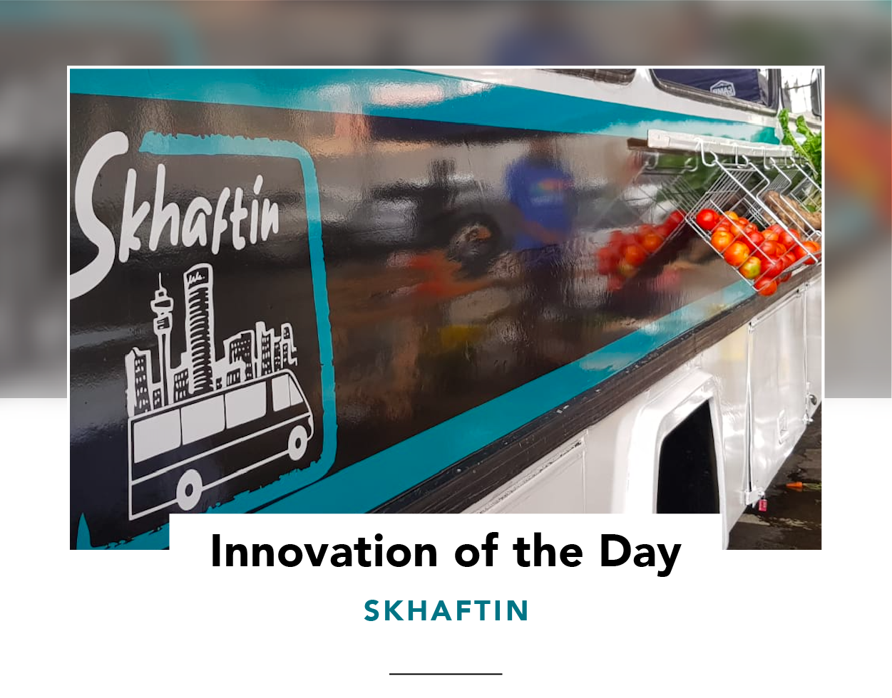 Side view of the Skhaftin bus, with baskets of vegetables hung outside