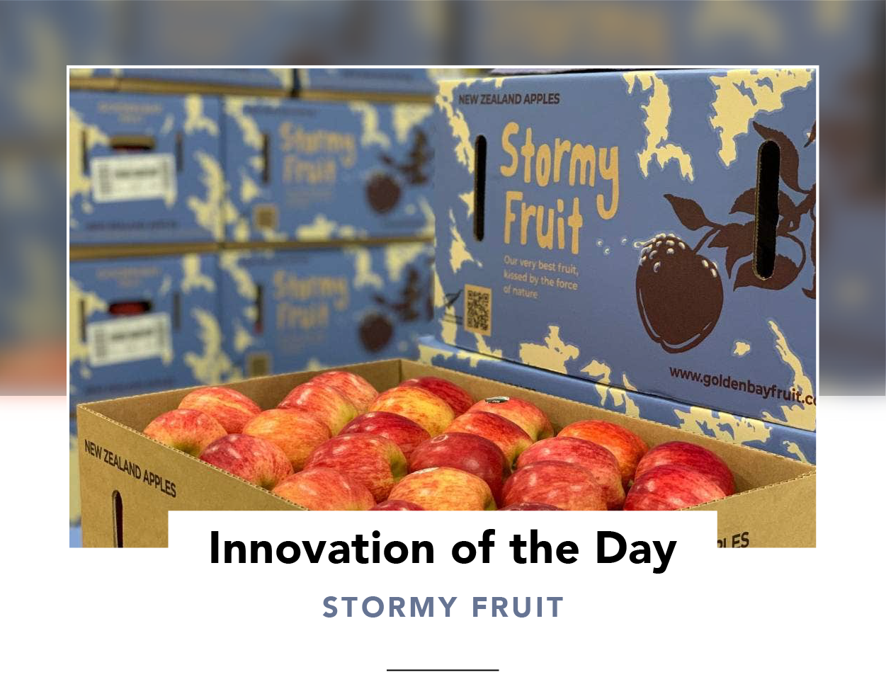 An open box of apples next to a lid showing 'Stormy Fruit' branding